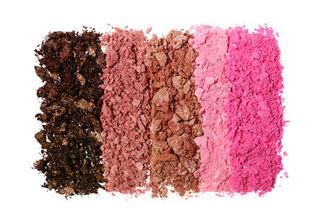 Crushed colored shiny eyeshadow as sample of cosmetic product isolated on white background Фото со стока