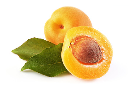 Ripe fruit for healthy life. Fresh apricot with green leaves isolated on white background Stock Photo