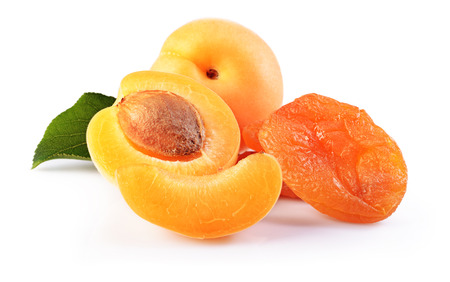 apricot kernels: Ripe fruit for healthy life. Fresh and dried apricot with green leaf isolated on white background Stock Photo