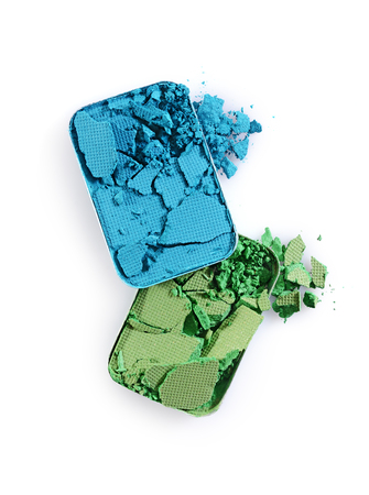 Blue and green crushed eyeshadow for make up as sample of cosmetic product isolated on white background