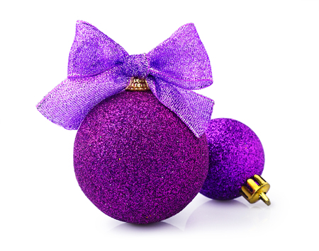 Beautiful glittering purple christmas balls with bright ribbon isolated on white background Stock Photo