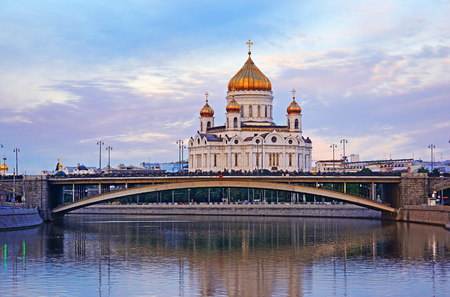 Cityscape view from the river with bridge to The cathedral church of Christ the Savior in Moscow, Russia