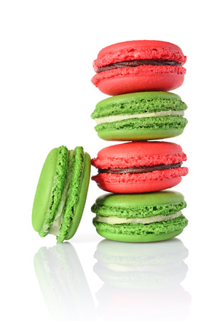 French dessert. Sweet green and red macaroons or macarons isolated on white background