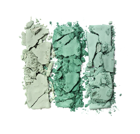 Green crushed eyeshadow for make up as sample of cosmetic product isolated on white background Stock Photo