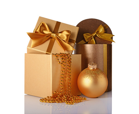 Bronze and golden classic gift boxes with satin bows, beaded garlands and christmas ball isolated on white background