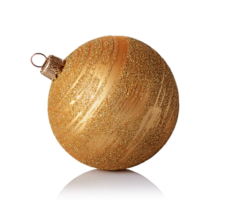Close-up of beautiful gold christmas ball with golden glittering pattern isolated on white background Stock Photo