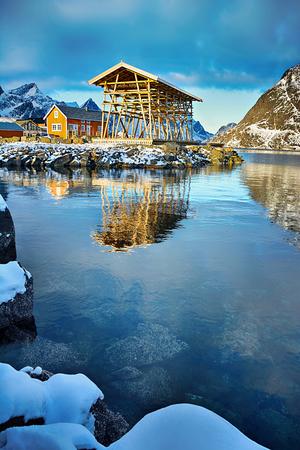 Beautiful winter landscape with traditional fishing huts rorbu in Lofoten islands in Norwegian Sea, Norway
