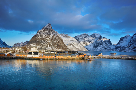 Beautiful winter landscape of picturesque fishing village in the mountains of Lofoten islands in Norwegian Sea, Norway Stock Photo