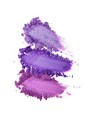 Smear of crushed purple eye shadow as sample of cosmetic product isolated on white background