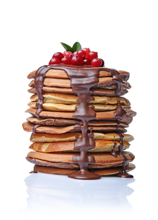 Tasty breakfast. Homemade pancakes with fresh cranberry and melted chocolate isolated on white background
