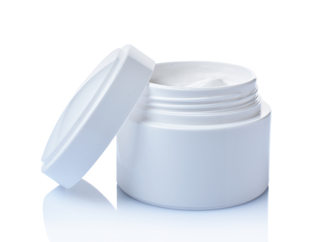 Opened white mockup jar of cosmetic facial cream isolated on white background