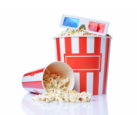 Large bucket and small cup of appetizing salty popcorn with 3d anaglyph glasses isolated on a white background
