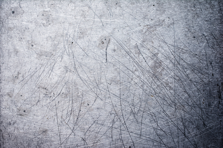 Gray grunge metallic texture background with scratches for design Banco de Imagens