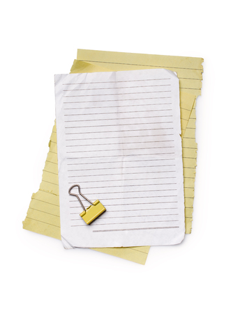 Mockup of empty lined paper sheets with yellow clip isolated on white background Imagens