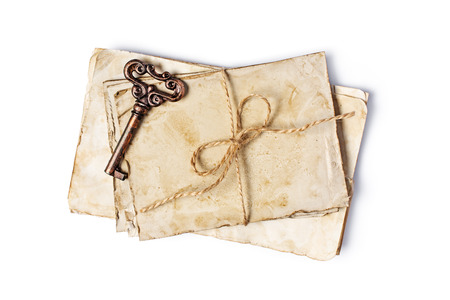 Top view on bunch of empty old vintage yellowed paper sheets or letters with rope isolated on white background Archivio Fotografico