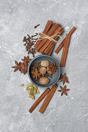 Winter spices in bowl for mulled wine on gray concrete background Stock Photo