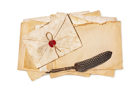 Vintage composition with yellowed letters in envelope and luxury quill pen isolated on white background