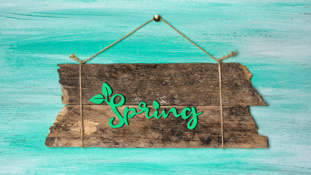 Vintage signboard for information hanging by rope on rustic turquoise wooden background