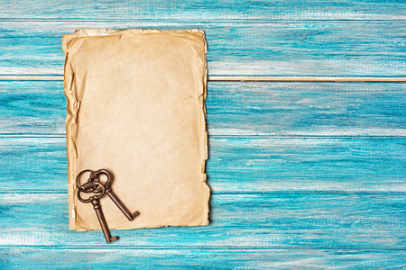 Mockup of empty old vintage paper sheets with retro keys on blue wooden background with copy space Archivio Fotografico