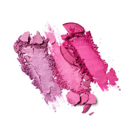 Brush stroke of shiny crushed bright purple and pink eye shadow as sample of cosmetic product isolated on white background Banco de Imagens