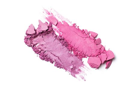 Brush stroke of shiny crushed bright purple and pink eye shadow as sample of cosmetic product isolated on white background 写真素材