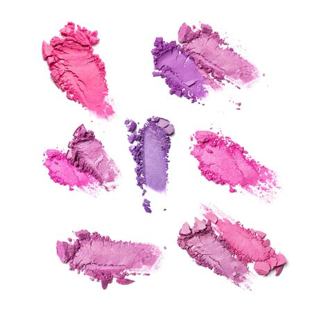 Brush stroke set of shiny crushed bright purple and pink eye shadow as sample of cosmetic product isolated on white background