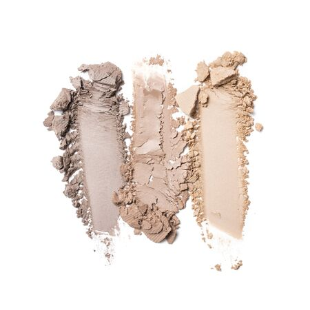 Brush strokes of crushed nude beige eye shadow as sample of cosmetic product isolated on white background