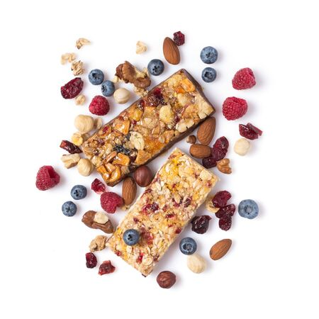 Top view of granola energy bar with fresh raspberry, blueberry and mix of nuts for healthy nutrition isolated on white background