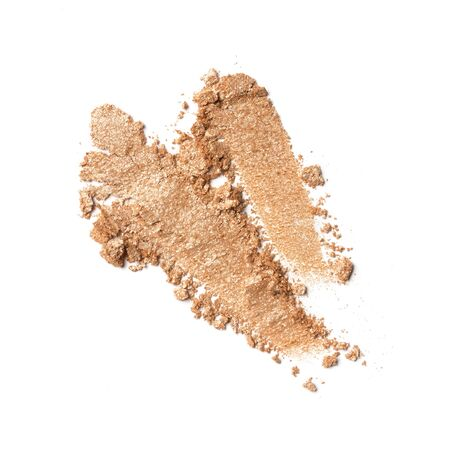 Brush strokes of shiny crushed beige eye shadow as sample of cosmetic product isolated on white background
