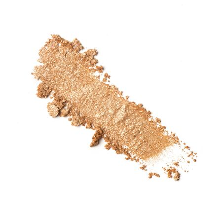 Brush stroke of shiny crushed beige eye shadow as sample of cosmetic product isolated on white background