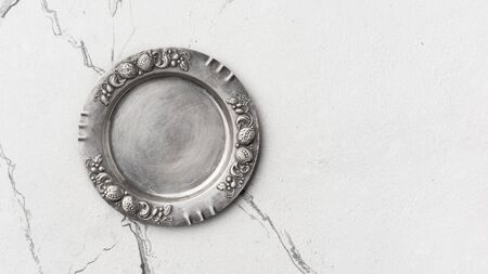Top view of vintage silver tableware on white marble background with copy space