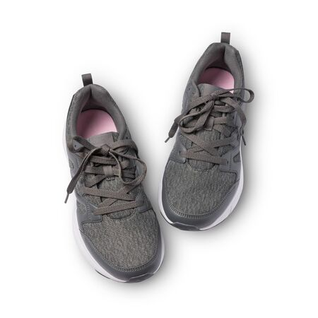 Top view of dark gray with pink sport shoes for street style isolated on white background