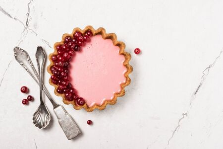 Top view of tasty berry dessert with vintage silver cutlery on white marble background with copy space Imagens