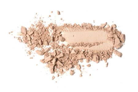 Brush strokes of crushed light beige eye shadow as sample of cosmetic product isolated on white background