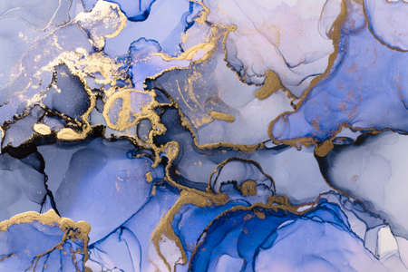Closeup of blue and shiny golden alcohol ink abstract texture, trendy wallpaper. Art for design project as background for invitation or greeting cards, flyer, poster, presentation, wrapping paper Banco de Imagens