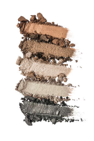 Flat lay of brush strokes. Broken color eyeshadow as samples of cosmetic beauty products isolated on white background