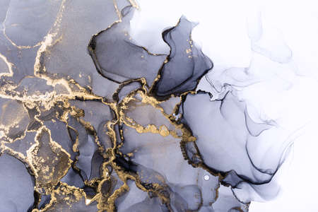 Closeup of grey and shiny golden alcohol ink abstract texture, trendy wallpaper. Art for design project as background for invitation or greeting cards, flyer, poster, presentation, wrapping paper