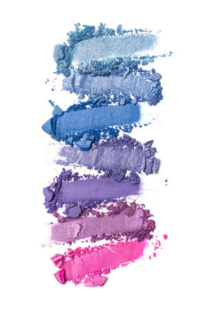 Flat lay of brush strokes. Broken shiny bright color eyeshadow as samples of cosmetic beauty products isolated on white background 版權商用圖片