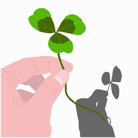 three leaf clover in hand