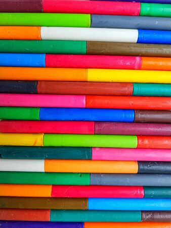 Lots of colorful wax pencils that take up the entire field of view. High quality photo