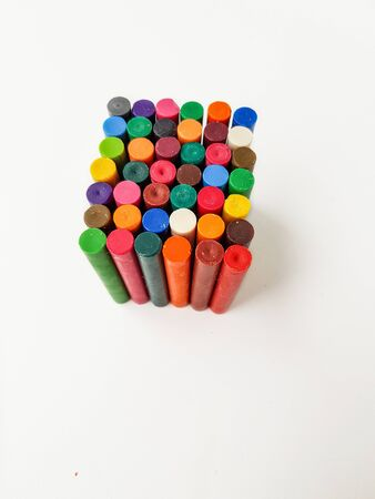 Cube of colored chalk pencils on a white background. High quality photo.