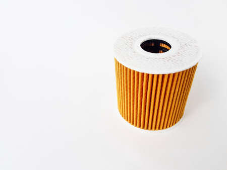 Car oil filter on a white background. Space for text. Isolate. High quality photo