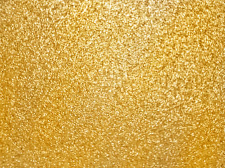 Defocusing. Golden textured shiny background with glitter. Holidays and birthdays. Space for text. High quality photo