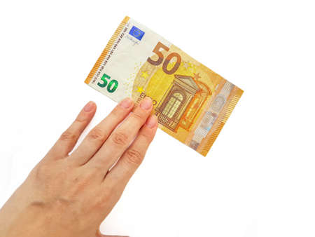The womans hand holds the paper money of the euro against a white background. Greed. Debts. Salary. Credit. High quality photo Archivio Fotografico - 151070475