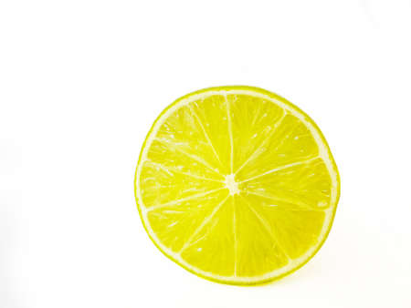 Bright juicy green lime on a white background cut in half. . High quality photo