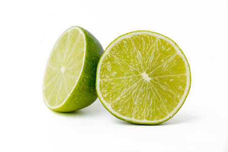 Bright juicy sour lime on a white background cut in half. High quality photo Reklamní fotografie