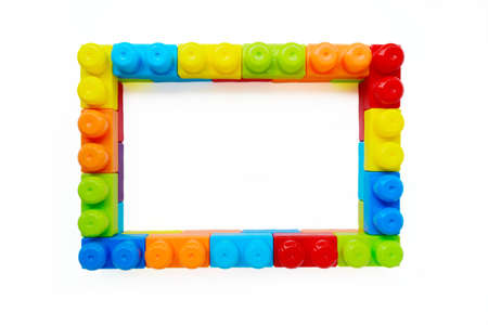 Bright multi-colored childrens designer in the form of a frame on a white background. Interesting educational games for children. A place for your text. High quality photo