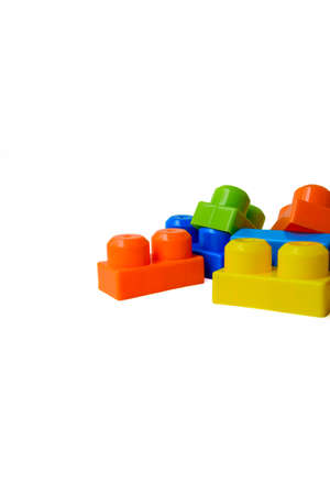 Scattered bright multi-colored childrens designer on a white background. Childhood. Useful and interesting games. High quality photo