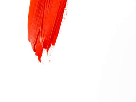 A smear of red paint on a white background. A place for text. . High quality photo