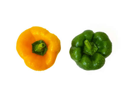 Green and yellow bell pepper on a white background. The concept of a healthy diet. . High quality photo